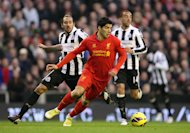 Luis Suarez, centre, was on top form against Newcastle