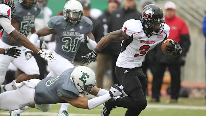 Northern Illinois running back Akeem Daniels (3) breaks away from Eastern Michigan's Dustin Creel for a touchdown during the first quarter of an NCAA college football game in Ypsilanti, Mich., Friday, Nov. 23, 2012. (AP Photo/Carlos Osorio)