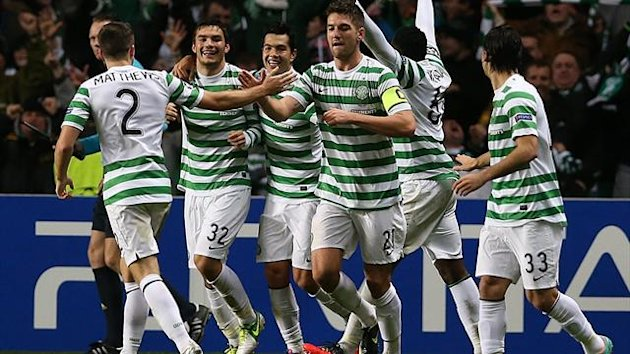 Celtic's Scottish striker Tony Watt (C) celebrates scoring during their UEFA Champions League Group G football match at Celtic Park in Glasgow
