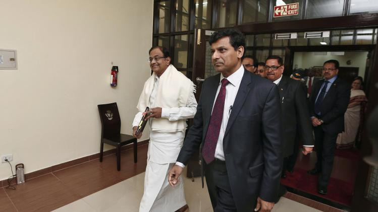 India's Finance Minister Chidambaram and RBI Governor Rajan arrive to address a joint news conference in New Delhi