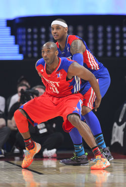 Max contracts for Kobe Bryant (left) and Carmelo Anthony would limit the Lakers' flexibility. (USA Today)