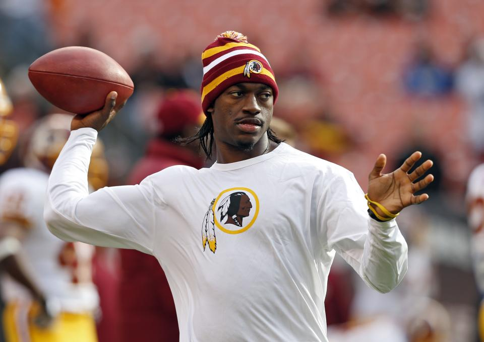 Washington Redskins quarterback Robert Griffin III tosses a ball during warmups before an NFL football game against the Cleveland Browns in Cleveland, Sunday, Dec. 16, 2012. Kirk Cousins will start in place of Griffin wgho is sitting out with a sprained knee. (AP Photo/Rick Osentoski)