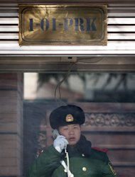 A Chinese paramilitary guard speaks on the phone outside the North Korean embassy in Beijing on February 12, 2013. North Korea had provided China and the United States with advance warning that a nuclear test was imminent