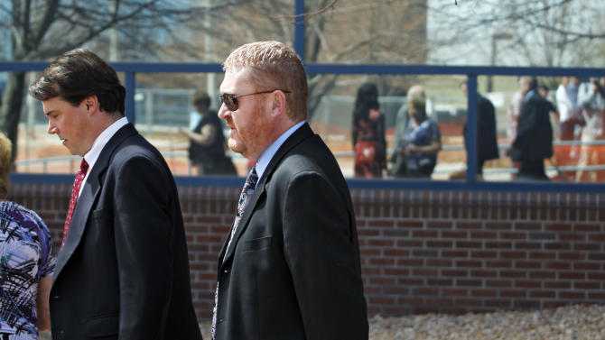 Defense attorney Daniel King, right, leaves the courthouse in Centennial, Colo., with a member of his team after a hearing where Aurora theater shooting suspect James Holmes asked to change his plea to not guilty by reason of insanity on Monday,  May 13, 2013. (AP Photo/Brennan Linsley)