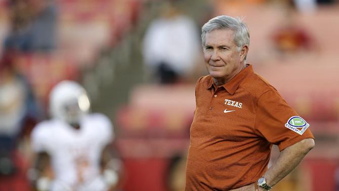 """ZThis is an Oct. 3, 2013 file photo showing University of Texas football head coach Mack Brown watching his team warm up before an NCAA college football game against Iowa State, in Ames, Iowa. Former Texas coach Brown will serve as a studio analyst for college football games on ABC. Brown stepped down in December after 16 years with the Longhorns, winning the national title after the 2005 season. Brown will appear on """"College Football Countdown"""" and offer pregame, halftime and postgame commentary for the games on ABC, including """"Saturday Night Football."""""""