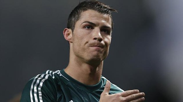 Real Madrid&#39;s Cristiano Ronaldo reacts after the Champions League soccer match against Manchester United at Old Trafford stadium in Manchester, March 5, 2013. (Reuters)