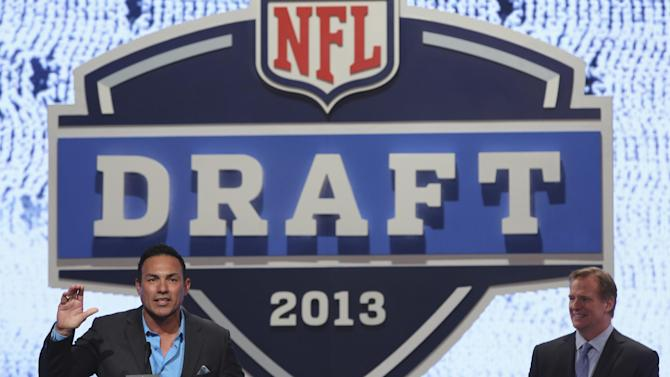Former Atlanta Falcons defensive tackle Tony Casillas is joined by NFL commissioner Roger Goodell as he announces a draft pick during the second round of the NFL Draft, Friday, April 26, 2013 at Radio City Music Hall in New York.  (AP Photo/Mary Altaffer)