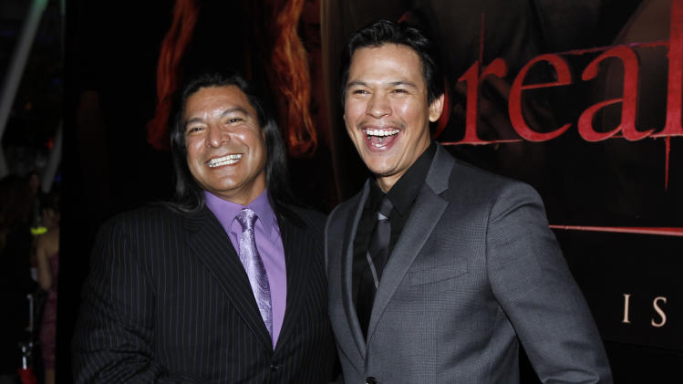 "Gil Birmingham, left, and Chaske Spencer arrive at the world premiere of ""The Twilight Saga: Breaking Dawn - Part 1"" on Monday, Nov. 14, 2011, in Los Angeles. (AP Photo/Matt Sayles)"