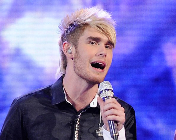 FILE - In this April 11, 2012 file photo released by Fox, Colton Dixon performs on the singing competition series &quot;American Idol,&quot; in Los Angeles. The 20-year-old alt-rocker was revealed Thursday, April 19, 2012 to have received the fewest viewer votes on the Fox talent competition. Dixon was surprisingly eliminated from &quot;Idol&quot; after delivering lukewarm renditions of Lady Gaga&#39;s &quot;Bad Romance&quot; and Earth Wind and Fire&#39;s &quot;September&quot; on Wednesday&#39;s evening of old and new tunes. (AP Photo/Fox, Michael Becker, File)