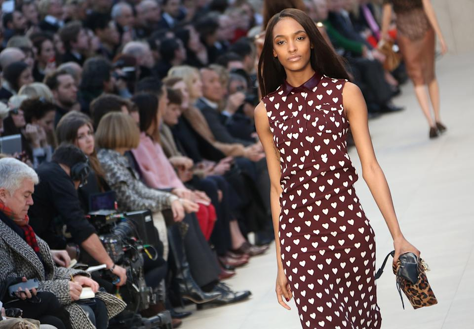 British model Jourdan Dunn wears a design created by Burberry Prorsum during London Fashion Week, at Kensington Gardens in west London, Monday, Feb. 18, 2013. (Photo by Joel Ryan/Invision/AP)