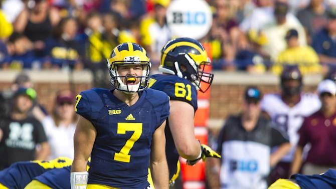 Michigan quarterback Shane Morris (7) shouts at his offensive line in the second quarter of an NCAA college football game against Minnesota in Ann Arbor, Mich., Saturday, Sept. 27, 2014. (AP Photo/Tony Ding)