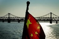 File illustration photo shows the Yalu Bridge at the Chinese-North Korean border town of Dandong in December 2011. China has allowed six North Korean refugees to leave for South Korea after they spent months holed up in Seoul's consular offices in China, news reports said Friday