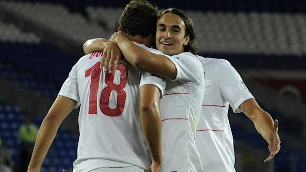 Serbia's Lazar Markovic (R) celebrates after Filip Dordevic scores a goal against Wales during their 2014 World Cup qualifying match at Cardiff City Stadium, September 10, 2013 (Reuters)