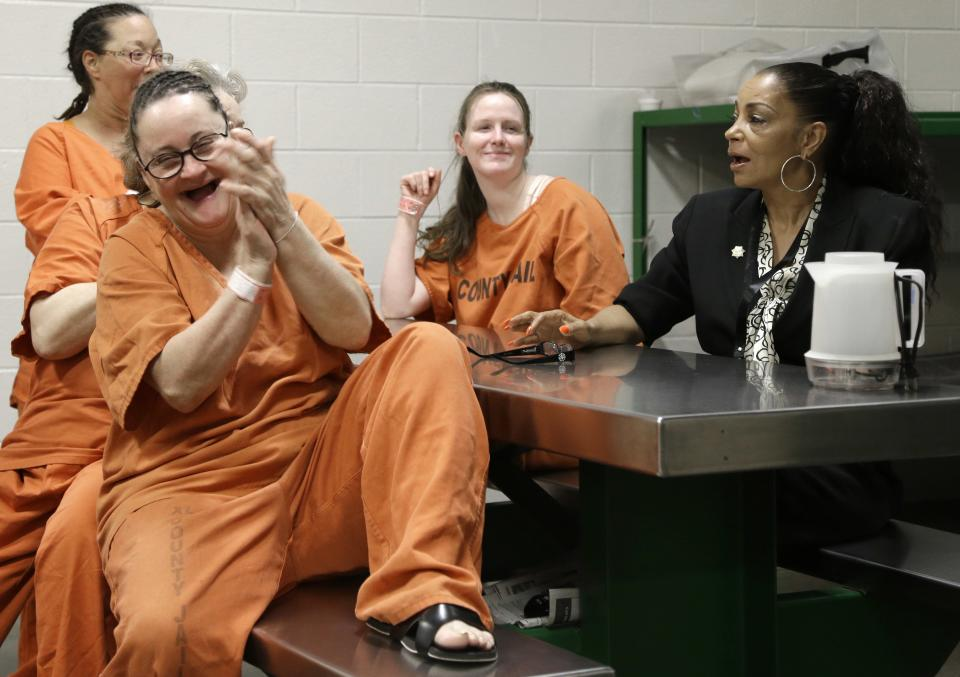 Inmate Rebecca Gass, right, laughs as Kathryn Griffin Grinan, right, counsels the women during a group session of We've Been There Done That program Tuesday, June 4, 2013, in Houston's Harris County jail. The program helps rehabilitate prostitutes. (AP Photo/Pat Sullivan)