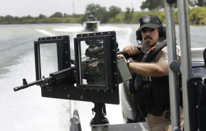 Texas Department of Safety Troopers patrol on the Rio Grande along the U.S.-Mexico border on patrol near Mission