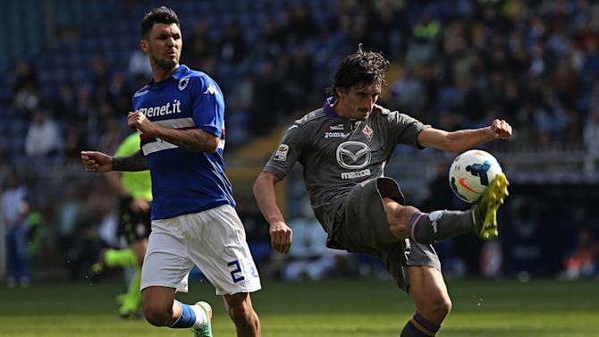 Fiorentina defender Stefan Savic, right, controls the ball past Sampdoria midfielder Roberto Soriano during a Serie A soccer match between Sampdoria and Fiorentina, in Genoa, Italy, Sunday, March 30, 2014