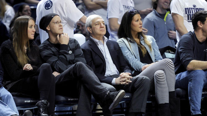 Former Penn State president Graham Spanier watches the Penn State men's basketball game against Nebraska, Saturday, Jan. 19, 2013 at the Bryce Jordan Center in State College, Pa. (AP Photo/Centre Daily Times, Abby Drey) MANDATORY CREDIT; MAGS OUT