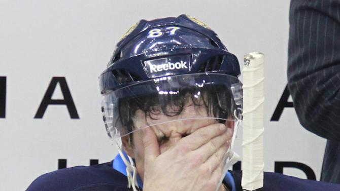 FILE - In this Nov. 25, 2011 file photo, Pittsburgh Penguins' Sidney Crosby sits on the bench during a time out in an NHL hockey game against the Ottawa Senators in Pittsburgh. A year after his return from concussion-like symptoms, Crosby is his old self. And due to the fallout from the devastating hit he took more than two years ago, the NHL may be better off for it.(AP Photo/Gene J. Puskar, File)