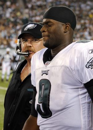 Philadelphia Eagles' Vince Young, right, leaves the field with Eagles coach Andy Reid after being injured during the second quarter of an NFL preseason football game against the New York Jets, Thursday, Sept. 1, 2011, in East Rutherford, N.J. (AP Photo/Henny Ray Abrams)