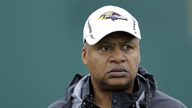 FILE - In this Jan. 30, 2013, file photo, Baltimore Ravens offensive coordinator Jim Caldwell walks onto the field as his team warms up during an NFL Super Bowl XLVII football practice in New Orleans. A person familiar with the situation says the Detroit Lions have hired coach Caldwell. (AP Photo/Patrick Semansky, File)