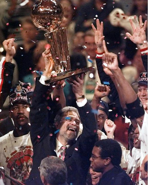 In this June 13, 1997 file photo, Chicago Bulls coach Phil Jackson hoists the trophy aloft after the Bulls beat the Utah Jazz 90-86 in Game 6 to win the NBA championship in Chicago. Jackson will be in