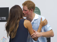 Britain&#39;s Prince Harry greets Brazilian model Fernanda Motta during an award ceremony after playing a charity polo match in Campinas, Brazil, Sunday March 11, 2012. Prince Harry is in Brazil at the request of the British government on a trip to promote ties and emphasize the transition from the upcoming 2012 London Games to the 2016 Olympics in Rio de Janeiro. (AP Photo/Andre Penner)