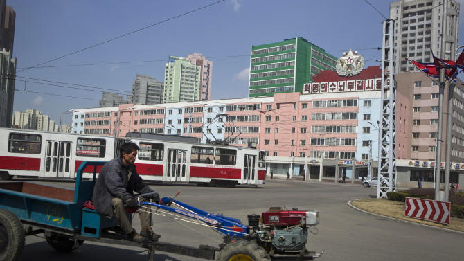 A North Korean man drives a small tractor in central Pyongyang, North Korea on Wednesday April 10, 2013. (AP Photo/David Guttenfelder)