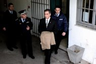 Vassilis Papageorgopoulos, former mayor of the Greek port city of Thessaloniki, is escorted to prison on February 27, 2013. Greece has finally begun to crack down on corrupt politicians but anti-graft experts say much remains to be done to end decades of impunity