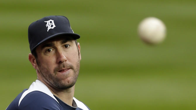 Detroit Tigers pitcher Justin Verlander warms up during a workout at Comerica Park in Detroit, Friday, Oct. 26, 2012. The Tigers host the San Francisco Giants in Game 3 of baseball's World Series on Saturday. The Giants lead the best-of-seven games series 2-0. (AP Photo/Paul Sancya )