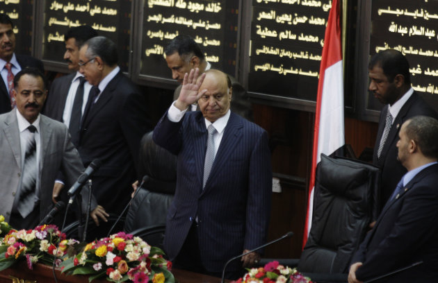 Yemen's newly elected President Abed Rabbu Mansour Hadi waves as he arrives to the Parliament in Sanaa, Yemen, Saturday, Feb. 25, 2012. Hadi took the oath of office before the country's parliament Saturday. He replaces Ali Abdullah Saleh, who ruled the country for 33 years before leaving office in a power transfer deal aimed at ending over a year of political turmoil.(AP Photo/Hani Mohammed)