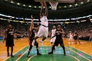 Boston Celtics' Brandon Bass attempts a dunk during game four of their NBA Eastern Conference finals playoff series on June 3. Either the Heat or the Celtics will face the Western Conference champions, the San Antonio Spurs or Oklahoma City Thunder, in the NBA Finals