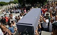 Relatives and friends of opposition leader Oswaldo Paya carry his coffin during his funeral at Cristobal Colon cemetery in Havana. Cuban police arrested dozens of dissidents Tuesday after the funeral of Oswaldo Paya, a political activist whose sudden death in a road accident triggered grief and suspicion, AFP reporters said