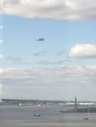 The prototype space shuttle Enterprise flies over the Statue of Liberty on April 27, 2012, in this shot by Lery PointDuJour.