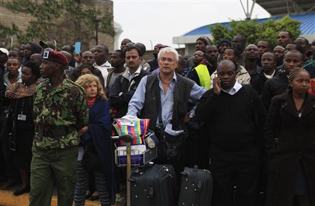 Stranded passengers and onlookers crowd together after fire disrupted all operations at Jomo Kenyatta International Airport in Nairobi