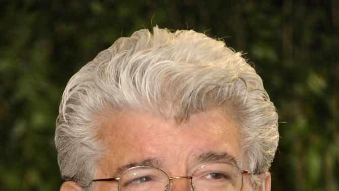 """FILE - In this Feb. 26, 2012 file photo, George Lucas arrives at the Vanity Fair Oscar party in West Hollywood, Calif.  A decade after George Lucas said """"Star Wars"""" was finished on the big screen, a new trilogy is destined for theaters after The Walt Disney Co. announced Tuesday, Oct. 30, 2012, that it was buying Lucasfilm Ltd. for $4.05 billion. (AP Photo/Evan Agostini, File)"""