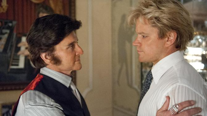 """This film image released by HBO shows Michael Douglas, left, as Liberace, and Matt Damon, as Scott Thorson in a scene from """"Behind the Candelabra,"""" premiering Sunday at 9 p.m. EDT on HBO. (AP Photo/HBO, Claudette Barius)"""