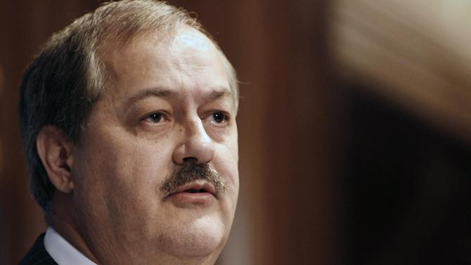 FILE -In this Thursday, July 22, 2010 file photo, Chairman and Chief Executive Officer of Massey Energy Company Don Blankenship speaks at the National Press Club in Washington. David Hughart, a former president of a Massey Energy subsidiary implicated the company's chief executive officer in safety violations as he pleaded guilty Thursday, Feb. 28, 2013, to charges resulting from an investigation into the 2010 explosion at a Massey mine that killed 29 men. The CEO at the time, Don Blankenship, was not mentioned by name. (AP Photo/Jacquelyn Martin, File)