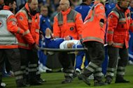 Schalke's Julian Draxler is carried on a strecher following an injury during their UEFA Champions League Group B match against Montpellier, in Gelsenkirchen, western Germany. The match ended in a 2-2 draw
