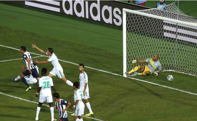 Jose Maria Basanta of Mexico's Monterrey scores a goal against Morocco's Raja Casablanca during their FIFA Club World Cup soccer match in Agadir