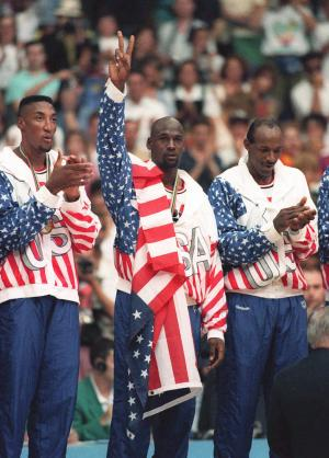 """FILE -In this Aug. 8, 1992 photo, the USA's Scottie Pippen, left, with Michael Jordan, center, and Clyde Drexler, pose with their gold medals after beating in Barcelona. Jordan tells the Associated Press that he laughed when heard Kobe Bryant said this year's USA Olympic basketball team could beat the Dream Team that Jordan played on. Jordan said """"It's not even a question"""" who would have won that game. """"We had 11 Hall of Famers on that team. Whenever they get 11 Hall of Famers you call and ask me."""" (AP Photo/Susan Ragan)"""