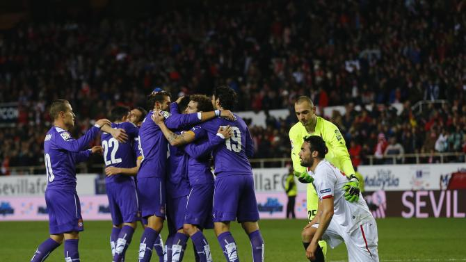 Espanyol's players celebrates next to Sevilla's Vicente Iborra after winning their Spanish King's Cup quarterfinal second leg soccer match in Seville