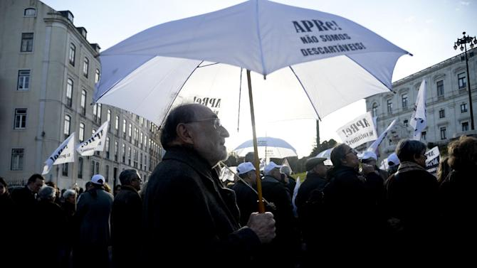 Pensioners protest in front of the Portuguese parliament in Lisbon on January 22, 2014 against further declines in their state pensions