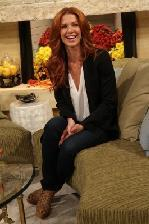Poppy Montgomery is all smiles on the set of Access Hollywood Live in Burbank, Calif., on November 14, 2011 -- Access Hollywood