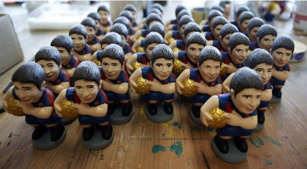 "FC Barcelona's soccer Lionel Messi ""caganers"" figurines are seen in a pottery stall in Torroella de Montgri"