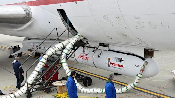 """This undated photo provided by NASA shows the Orbital Sciences Corporation Pegasus XL rocket with the NuSTAR spacecraft after attachment to the L-1011 carrier aircraft known as """"Stargazer."""" The Pegasus will launch NuSTAR into space, Wednesday June 13, 2012 where the high-energy X-ray telescope will conduct a census for black holes, map radioactive material in young supernovae remnants, and study the origins of cosmic rays and extreme physics around collapsed stars. (AP Photo/NASA, Randy Beaudoin)"""