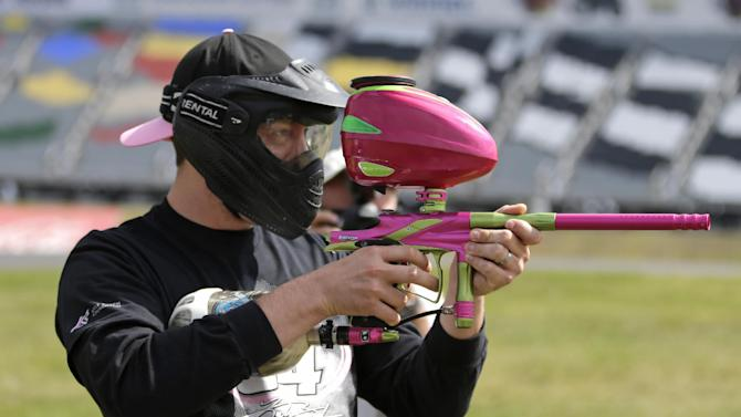 NASCAR driver Kyle Busch prepares for a paintball game against members of the media at Charlotte Motor Speedway in Concord, N.C., Tuesday, Sept. 24, 2013, promoting the upcoming Bank of America 500 NASCAR Sprint Cup auto race on Oct. 12, 2013