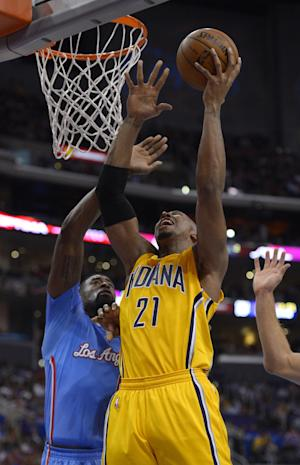 Indiana Pacers forward David West, right, puts up a shot as Los Angeles Clippers center DeAndre Jordan defends during the first half of an NBA basketball game, Sunday, Dec. 1, 2013, in Los Angeles. (AP Photo/Mark J. Terrill)