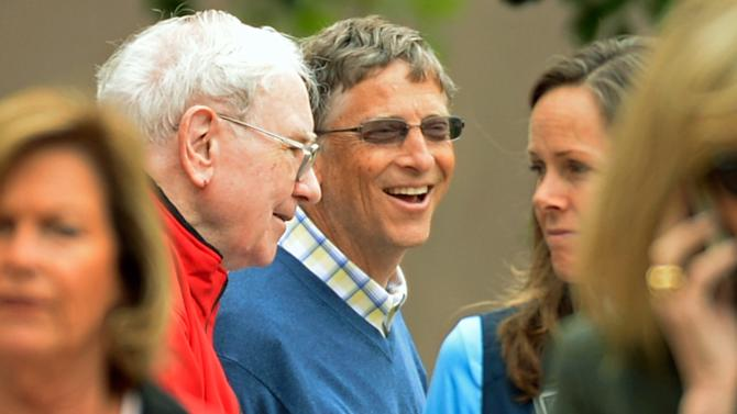 Chairman of Microsoft Bill Gates (R) and chairman and CEO of Berkshire Hathaway Warren Buffett break for lunch during the Allen & Co. annual conference at the Sun Valley Resort on July 11, 2013 in Sun Valley, Idaho