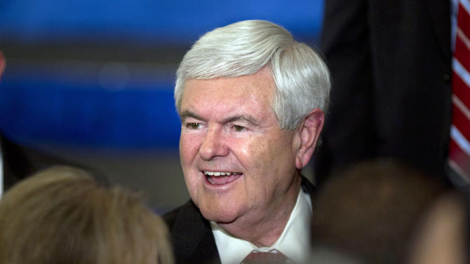 Republican presidential candidate, former House Speaker Newt Gingrich smiles as he shakes hands during a Super Tuesday rally on Tuesday, March 6, 2012 in Atlanta.  (AP Photo/Evan Vucci)