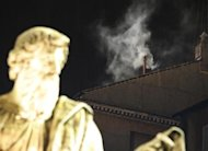 White smoke rises from the chimney above the Sistine Chapel in the Vatican, indicating a new pope has been elected at the Vatican March 13, 2013. REUTERS/Tony Gentile